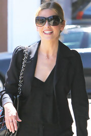 Sarah Michelle paired her sleek blazer with cool butterfly shades.