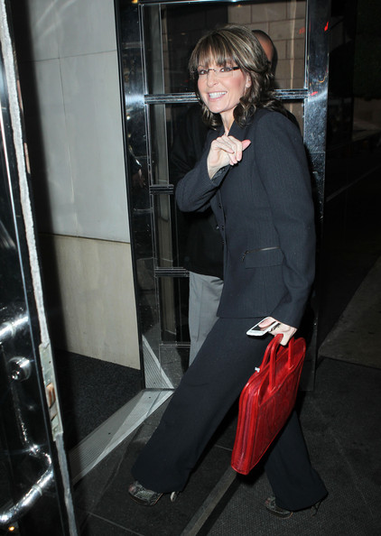 Sarah Palin punched up a black suit with a bright red leather briefcase.