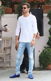 Scott Disick kept his daytime look simple and casual with a white long-sleeve tee and jeans.
