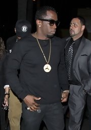 Sean Combs was out and about in Hollywood wearing a black crewneck sweater spiced up with a huge gold pendant necklace.