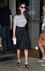 For her footwear, Selena Gomez chose a pair of strappy black mules by Kurt Geiger.
