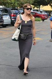 Selma Blair chose a charcoal-colored, sleeveless maxi dress with a fishtail hem for her summer look at the farmers market.