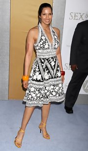 Padma added color to her printed halter dress with strappy yellow sandals and chunky bangle bracelets.