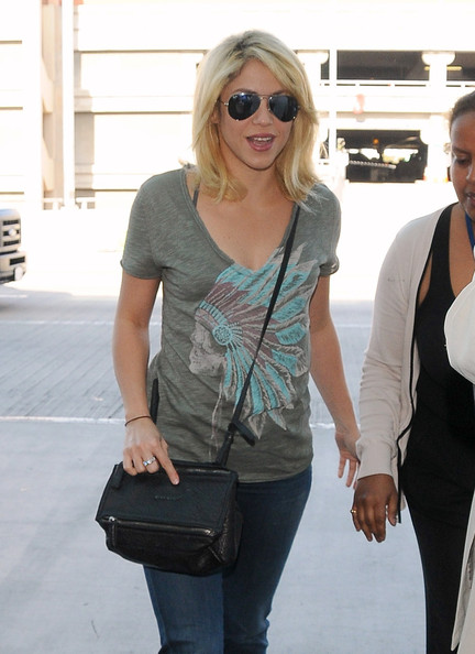Shakira in a graphic tee.