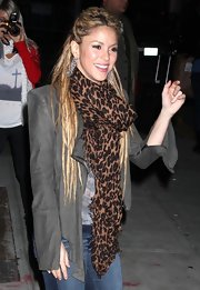 Shakira pulled her twisted dreads into a half up hairstyle for a talk show appearance. She looked polished and still kept her sexy, exotic look.