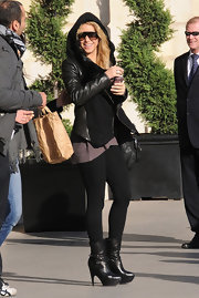 Shakira went incognito in black leather mid-calf boots with extra tall platforms. The songstress wore the boots over basic black leggings and paired them with a leather and fleece hooded jacket.