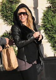 Shakira wore a fur embellished leather jacket with a wool zip front while in Paris.