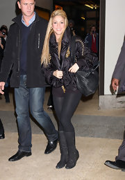Shakira dons simple knee-high boots with her leggings while leaving the MTV Studios in NYC.
