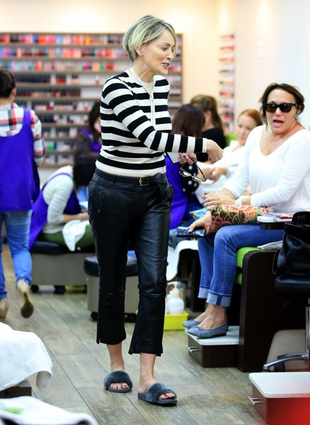 Sharon Stone looked youthful in a black-and-white striped sweater while visiting a Beverly Hills nail salon.