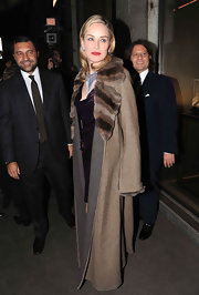 Sharon Stone brought glamor to the Damiani party in a long brown coat with fur lapels.