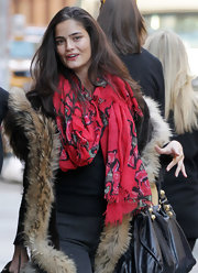 Shermine Shahrivar looked great in a casual look wearing a comfy coat, tee, and pants teamed with a lovely floral scarf.
