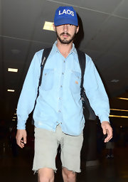 Shia LaBeouf was low-key in a denim button-down and cutoffs as he arrived at JFK Airport.