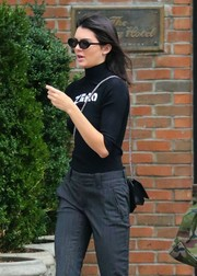 Kendall Jenner teamed a black Alyx 'Zero' turtleneck with gray slacks for a day out in New York City.