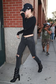 Kendall Jenner toughened up her look with a pair of ripped jeans.