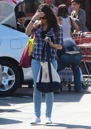 Mila Kunis teamed her top with blue skinny jeans by AG.
