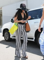 Vanessa Hudgens went shopping in Beverly Hills looking sexy in a black halter top.