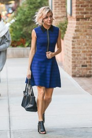 Sienna Miller was edgy-cute in a striped blue A.L.C. mini dress with a zipper front and leather trim as she headed to her NYC hotel.