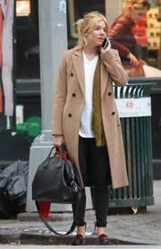 Sienna Miller was spotted out and about in New York City carrying a Givenchy Nightingale bag, in black.