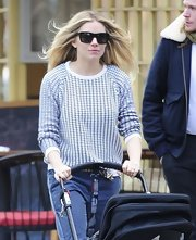 Sienna Miller chose a super casual crew neck sweater for a stroll out with baby Marlowe.