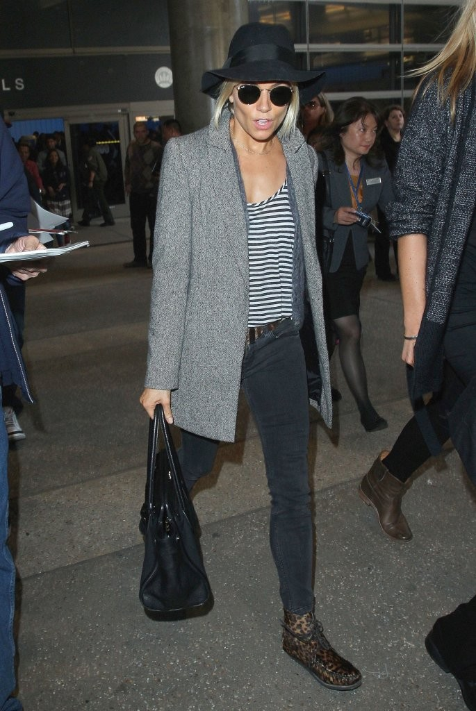 Sienna Miller Touches Down At LAX