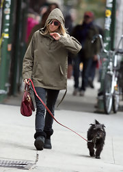 Sienna dresses comfortably for a brisk walk with her dog.