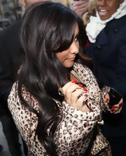 Snooki is rocking some fierce fake red nails with her leopard print ensemble.