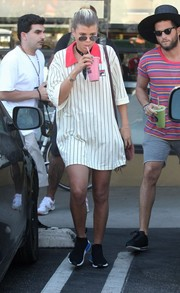Sofia Richie went on a smoothie run wearing an oversized striped polo shirt by Fila.