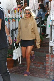 Sofia Richie finished off her look with cute lavender marabou slides by Brother Vellies.
