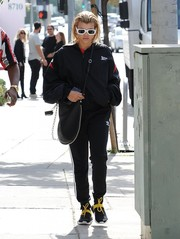 Sofia Richie bundled up in a black Vetements x Reebok track jacket for a day out in West Hollywood.