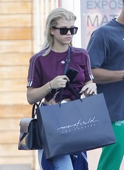Sofia Richie went shopping at Maxfield wearing modern square sunglasses.