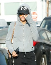 Sofia Richie tried to keep a low profile with a Y-3 logo cap, a pair of shades, and a hoodie while out shopping.
