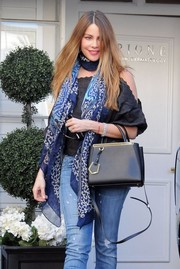 Sofia Vergara visited a skin care center wearing a patterned scarf and cold-shoulder top combo.
