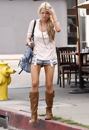 Sophie sported cut-off shorts with tan boots and a loose blouse.