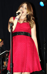 Sophie Simmons emphasized her curves by wearing a wide bejeweled belt on top of her plain dress.