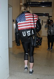 Sophie Turner flew out of LAX rocking a US flag leather jacket.