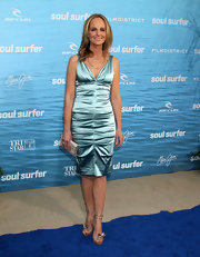 Helen Hunt gave her blue satin dress a whimsical touch with strappy gold sandals with flower embellishments.