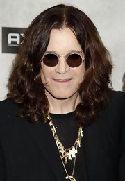 Ozzy Osbourne showed off his signiture round sunglasses while hitting the Guys Choice Awards.