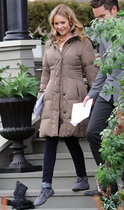 Britt Robertson kept warm with a tan down coat on the set of 'The Secret Circle.'