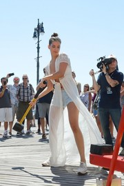 Barbara Palvin gave her beach attire some boho flavor with this flowing white coverup.