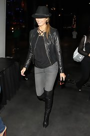 Stacy Keibler opted for a sleek concert style in gray skinny jeans, a black halter top and matching collarless leather jacket.
