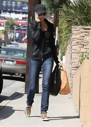 Stacy Keibler proved that she looks good off the red carpet too when she sported this shiny black zip-up jacket.