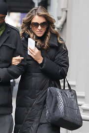 Elizabeth Hurley modernized her street style with a metallic textured satchel.