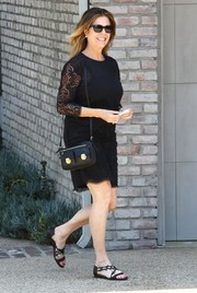 Rita Wilson chose a pair of flat black sandals to team with her dress.