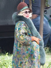 Lady Gaga was spotted on the set of 'American Horror Story: Hotel' looking vintage-chic in a brown, green, and gray cloche.