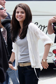 Selena was all smiles on set, sporting an eyelet top with jeans and a leather-band watch.