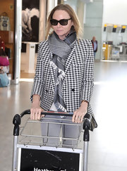 Stella McCartney channeled vintage boyish sophistication in this this plaid scarf at the airport.
