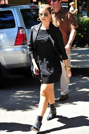 Lauren paired her black look with a cool pair of studded ankle boots.