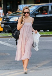 Suki Waterhouse was breezy and cute in a loose pink sundress while strolling in New York City