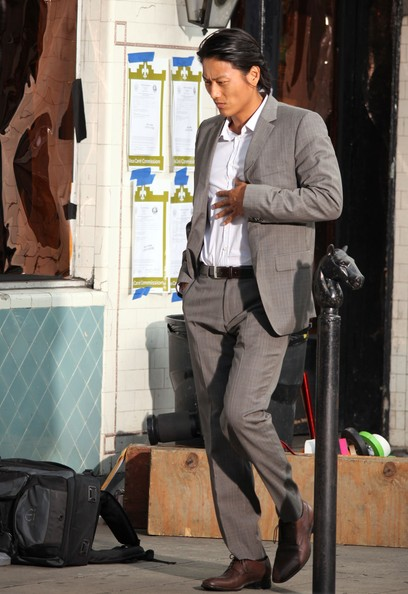 Sung Kang looked trim and stylish in a patterned gray suit.
