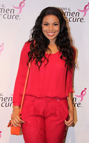 Jordin Sparks color-blocked her red-on-red outfit with a bright orange satchel.